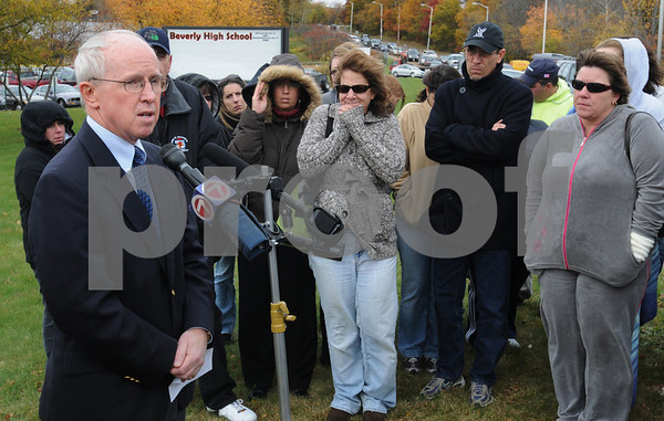 Beverly:<br /> Left,James Hayes, superintendant of schools, addresses the media and parents in front of Beverly High School. Also, Captain Alan Petersen of the Beverly Police spoke. The  lockdown of the school and the delayed dismissal time of 3 pm were discussed. There were 22 caliber long rifle bullets found in the school that prompted the decision to lockdown the school.<br /> Photo by Ken Yuszkus/Salem News, Wednesday, October 29, 2008.