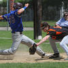 Beverly:<br /> Beverly's first baseman Kevin Cuneo reaches for the throw but Belmont's John Dillion gets back to first base on a pick off try during the Belmont at Beverly High state tournament baseball game.<br /> Photo by Ken Yuszkus/Salem News, Thursday, May 31, 2012.
