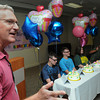 Beverly:<br /> From left, Dr. Peter Short, the quadruplets original pediatrician speaks about the quadruplets, Cullen, Killian, Emma, and Riley Driscoll at the start of their 15th birthday party held at Beverly Hospital.<br /> Photo by Ken Yuszkus/Salem News, Friday, July 13,  2012.