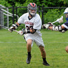 Marblehead:<br /> Marblehead's Zac Cuzwer runs the ball during the Triton at Marblehead High state tournament boys lacrosse game.<br /> Photo by Ken Yuszkus/Salem News, Wednesday, May 30, 2012.