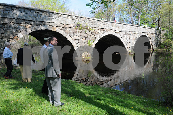 Hamilton:<br /> In the foreground, Scott Janes, acting Hamilton police chief, right, and Philip Stevens, Hamilton fire chief, look over the Ipswich River by the Highland Street/Mill Road bridge just before the ceremony to reopen the bridge. The bridge was closed for three years.<br /> Photo by Ken Yuszkus/Salem News, Friday May 8, 2009.