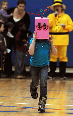 Salem:<br /> Suzhana Casteillo, kindergartener at the Carlton School, presents her word, blockhead, while running into the gym. She was part of the 15th annual vocabulary parade at the school. Each child chose his or her own word and a costume to match.<br /> Photo by Ken Yuszkus/Salem News, Thursday,  February 16, 2012.