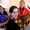 Danvers:<br /> From left, Sarah Carey with sousaphone, Maria Tenaglia with clarinet, and Christina Parr with bari saxaphone, are part of the Danvers High School band which is Hawaii bound. They are wearing leis for Hawaiian Day at the high school on Friday.<br /> Photo by Ken Yuszkus/Salem News, Friday, November 18, 2011.