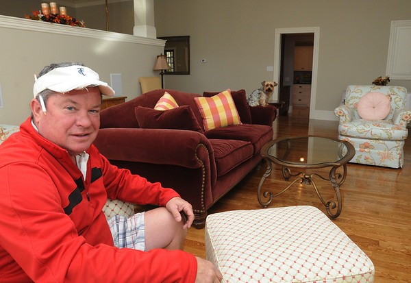 Swampscott:<br /> Steve Hayes sits in the family room in Swampscott's old fire station that Steve recently finished renovating. He has turned the building into his own family home. <br /> Photo by Ken Yuszkus/Salem News, Thursday, November 3, 2011.