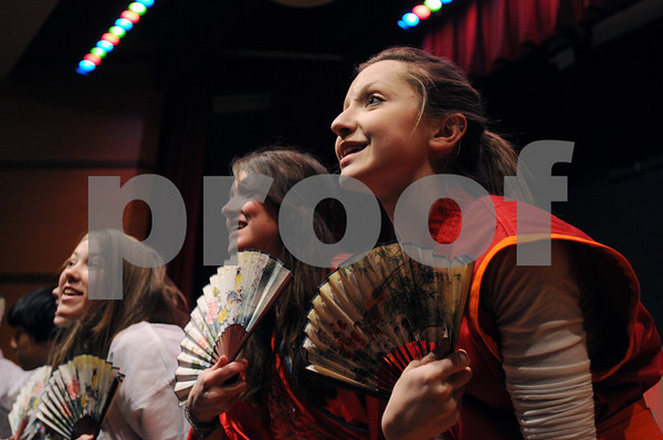 "Salem:<br /> From left, Mackenzie Borowski plays the part of Yao, Meryl Schultz as Mulan, and Catherine Majeski as Mushu, sing during dress rehearsal of the play ""Mulan"". The Collins Middle School's production of Mulan will run April 15 to 17.<br /> Photo by Ken Yuszkus/Salem News, Wednesday, April 8, 2009."