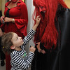 Danvers:<br /> Ruby Macheca, 6, reaches to touch Janna Noyes, who is in costume. Pamela Zimmerman, who is also in costume, looks on. Janna Noyes and Pamela Zimmerman are from the assessor's office in the Danvers Town Hall. The Town Hall was having a haunted house theme as part of the town wide open house.<br /> Photo by Ken Yuszkus/Salem News, Thursday, October 13, 2011.