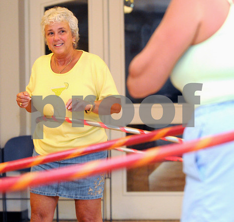 Ipswich:<br /> Sandy Noe spins her hula hoop non-stop during the weekly women's hula hoop session in the Senior Center in town hall.<br /> Photo by Ken Yuszkus/Salem News, Monday, August 10, 2009.