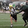 Peabody:<br /> P. J. Usalis is targeted by an Austin Prep player at the Austin Prep at Bishop Fenwick boys lacrosse game.<br /> Photo by Ken Yuszkus/Salem News, Monday, April 4, 2011.