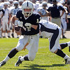 Danvers:<br /> St. John's Prep Tommy Gaudet gets by a Peabody player at the Peabody at St. John's Prep football game at Cronin Stadium. It was the season opener for both teams.<br /> Photo by Ken Yuszkus/Salem News, Saturday,  September 11, 2010.