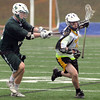 Peabody:<br /> Joe Shea brings the ball down field at the Austin Prep at Bishop Fenwick boys lacrosse game.<br /> Photo by Ken Yuszkus/Salem News, Monday, April 4, 2011.