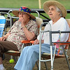 Beverly:<br /> Adele Belmonte, left, and Anna Ciarcia, both of Beverly, observe the activities during Senior Citizens Day at Lynch Park in Beverly<br /> Photo by Ken Yuszkus/Salem News, Thursday August 5, 2010.