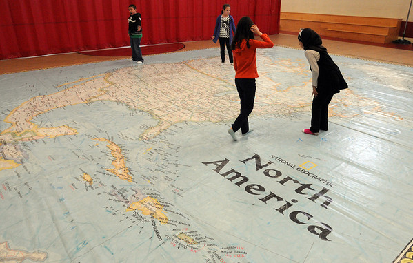 Salem:<br /> National Geographic's Giant Traveling Map of North America visited the Nathaniel Bowditch School. Jan Conlon's 3rd grade class explored the map which was laid out on the gymnasium floor.<br /> Photo by Ken Yuszkus/Salem News, Wednesday, March 9, 2011.
