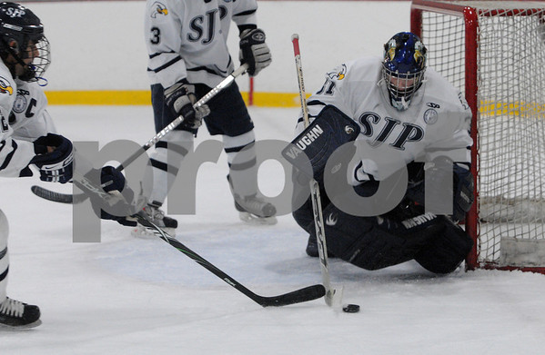 Wilmington:<br /> St. John's Prep goalie, Jonathan Siderewicz, protects the net from a shot in the game against Catholic Memorial at Ristuccia Arena.<br /> Photo by Ken Yuszkus/Salem News, Tuesday December 30, 2008.