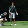"Danvers:<br /> Zach Cantin, left, lines up his shot on the 18th hole with Abdel Samir at his side during Boston Bruins player Shawn Thornton's annual ""Putts and Punches for Parkinson's"" charity golf fundraiser.<br /> Photo by Ken Yuszkus/Salem News, Monday, August 8, 2011."