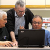 Beverly:<br /> Bob Hobbs, right, has questions about his laptop answered by Swift Lane, left, and Ed Chabot, center, at the computer lab at Beverly Council on Aging.<br /> Photo by Ken Yuszkus/Salem News, Friday, January 13, 2012.