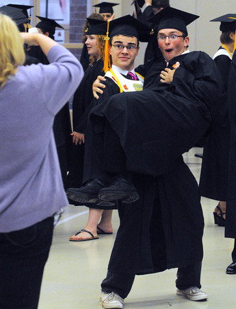 Ipswich:<br /> Andrew Whippen holds up Samuel Perakis while they have their photo taken before the start of the Ipswich High School graduation.<br /> Photo by Ken Yuszkus/Salem News, Sunday, June 3, 2012.