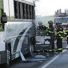 Danvers:<br /> Bus fire on Route 95 south near the Route 1 traffic circle.<br /> Photo by Ken Yuszkus/Salem News, Monday, June 20, 2011.