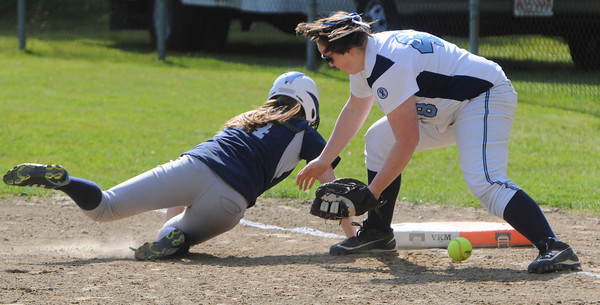Peabody:<br /> Swampscott's Tessa Beane safely dives back to first as Peabody's Mikayla Wallace misses the throw at the Swampscott at Peabody in Northeastern Conference softball game.<br /> Photo by Ken Yuszkus/Salem News, Monday, May 7, 2012.
