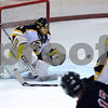 Peabody:<br /> Bishop Fenwick's goalie, Craig Forest, gets ready to intercept the shot on his goal at the Bishop Fenwick vs Marblehead boys hockey game at the McVann-O'Keefe Rink.<br /> Photo by Ken Yuszkus/Salem News, Saturday December 27, 2008.