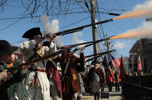 Peabody:<br /> The  Danvers Alarm List Company fire their rifles as part of the ceremonies honoring  the fallen soldiers from South Danvers (Peabody) at the Battle of Lexington at the start of the Revolutionary War. The ceremonies were held at the Lexington Monument on Washington Street Monday morning.<br /> Photo by Ken Yuszkus/Salem News, Monday, April 18, 2011.