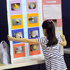 Beverly:<br /> Paris O'Brien, third grader, unfolds her science project display at the beginning of the 1st Annual Science Fair at Hannah School in Beverly. Her project explored how hot and cold affect marshmallo Peeps.<br /> Photo by Ken Yuszkus/Salem News, Tuesday, April 12, 2011.