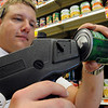 Salem:<br /> Mike Atkinson, grocery manager, applies a price tag to a can of corn at Crosby's grocery store.<br /> Photo by Ken Yuszkus/Salem News, Friday, May 21, 2010.