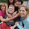Beverly:<br /> Surrounding Max Gaudenzi, sitting, are clockwise from left, Brenda Wilson, and Natalie Gaudenzi, Gina Vitale, Karen Gomes, all from Beverly. The women are training together for their first triathlon, the Dankskin Women's Triathlon July 24 in Webster, to raise money to support research into Duchenne Muscular Dystrophy. Natalie's son has DMD. The triathlon consists of a half-mile mile swim, a 12-mile bike ride and 5-kilometer run.<br /> Photo by Ken Yuszkus/Salem News, Friday, June 24, 2011.