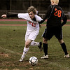Topsfield:<br /> Masco's Nevin Clay, left, gets his arm entangled with a Newton North player's arm while moving the ball down field during the Newton North at Masconomet boys soccer Division 1 North state tournament game.<br /> Photo by Ken Yuszkus/Salem News,  Tuesday,  November 9, 2010.