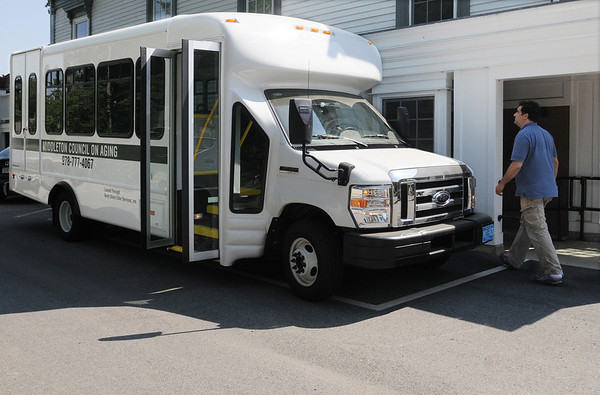 Middleton:<br /> Andy Diskes, who will be one of the drivers, checks out the new van before it takes on passengers for it's maiden trip from the parking lot of the Council on Aging. <br /> Photo by Ken Yuszkus/Salem News, Wednesday, May 26, 2010.