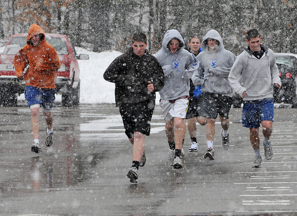 Danvers:<br /> Despite the snow, the Danvers boys lacrosse team ran five laps around the school at the beginning of their practice Monday. <br /> Photo by Ken Yuszkus/Salem News, Monday, March 21, 2011.