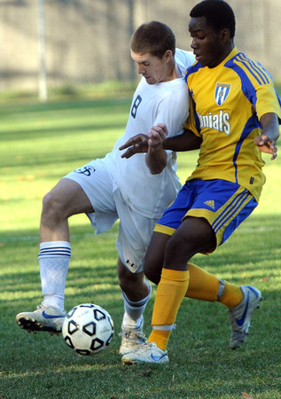 Danvers:<br /> St. John's Prep's Bryan Browne, left, keeps the ball away from an Acton-Boxboro player during the  Acton-Boxboro at St. John's Prep in Division 1 North state tournament boys soccer game.<br /> Photo by Ken Yuszkus/Salem News, Monday, November 7, 2011.
