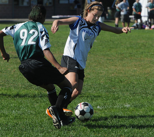 Peabody:<br /> Peabody's Molly Tansey right, controls the ball during the Peabody vs Lynn U14 game during the Peabody Youth Soccer's annual Columbus Day Tournament at Kennedy School fields.<br /> Photo by Ken Yuszkus/Salem News, Monday, October 10, 2011.