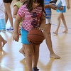 Danvers:<br /> Lilliana Monteve, 7, practices dribbling the basketball during free time at the Holten Richmond Middle School gym. Basketball was the game of the day at the Hip Hop Girls Club.<br /> Photo by Ken Yuszkus/Salem News, Thursday, July 19,  2012.