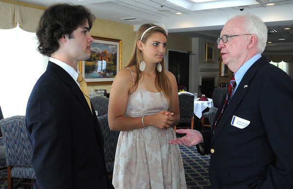 Peabody:<br /> Colin Blackwell and Rebecca Graves, the two Northshore Student Athlete of the Year award winners, speak with Gerard Moynihan, owner of Moynihan Lumber before the start of the dinner at Salem Country Club.<br /> Photo by Ken Yuszkus/Salem News, Thursday, June 9, 2011.