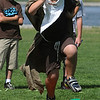 Beverly:<br /> Sam Falloni, dressed as Dumbledore, runs the obstacle course game called Quest For the Sorcer's Stone during the Harry Potter summer playground event at Lynch Park on Thursday.<br /> Photo by Ken Yuszkus/Salem News, Thurssday, July 14, 2011.