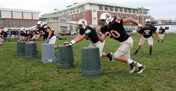 Beverly:<br /> The Beverly High School football players practice on the field at the school for the upcoming game.<br /> Photo by Ken Yuszkus/Salem News,  Wednesday,  November 10, 2010.
