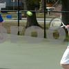 Danvers:<br /> The No. 1 doubles team of sophomore Michael DeSantis, left, and junior Kevin McManus, right,<br /> of the Danvers High boys tennis, practice at the Plains Park tennis courts.<br /> Photo by Ken Yuszkus/Salem News, Thursday, April 2, 2009.