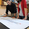 Salem:<br /> Andrew Keel, left, landscape designer, and Amanda Loughlin, environmental engineer, both employees at Bioengineering Group, look over plans at the company.<br /> Photo by Ken Yuszkus/Salem News, Thursday, September 15, 2011.
