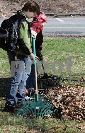 Beverly:<br /> Owen Bolas, left, and Colin Williams rake leaves and debris from in front of the Briscoe Middle School. The Build a Better Briscoe Club and volunteers focused on cleaning up the grounds, weeding, replanting the barrel plantings, planting flowers and assisting in recycling.<br /> Photo by Ken Yuszkus/Salem News, Wednesday, April 15, 2009.