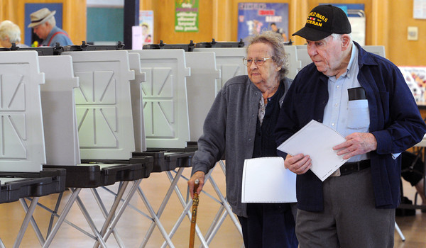 Hamilton:<br /> Jennie Cronin and her husband Robert bring their ballot to the ballot box after voting at Winthrop Elementary School during the town election.<br /> Photo by Ken Yuszkus/Salem News, Thursday, May 24, 2012.