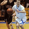 Danvers:<br /> Danvers' Cormick Powers gets ready to pass as Marblehead's Michael Dusenberry bears down on him during the Marblehead at Danvers Northeastern Conference boys basketball game.<br /> Photo by Ken Yuszkus/Salem News, Tuesday, February 8, 2011.
