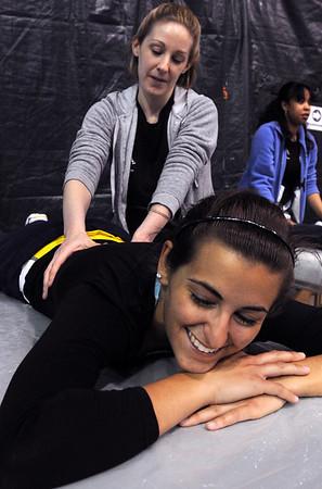 Salem:<br /> Karen Wells, massage therapist for Body & Soul, gives a free massage to April Rossetti of Salem, a junior at Salem State College, during the North Shore Wellness Fair at Salem State College O'Keefe Center on Sunday.<br /> Photo by Ken Yuszkus/Salem News, Sunday, April 11, 2010.