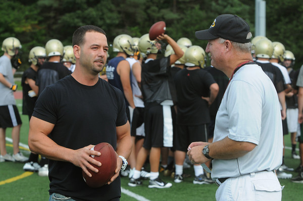 Peabody:<br /> Brett Belleville, left, speaks with his high school head coach Dave Woods on the field of Bishop Fenwick. Brett Belleville played football for Bishop Fenwick and is one of the best high school QBs of the last 40 years.<br /> Photo by Ken Yuszkus/The Salem News, Monday, August 20, 2012.