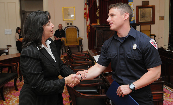 Salem:<br /> Mayor Driscoll shakes the hand of Salem firefighter Kevin O'Boyle who has returned from serving in Afghanistan.<br /> Photo by Ken Yuszkus/Salem News, Tuesday, May 22, 2012.