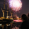 Salem:<br /> Charlotte Knight watches the fireworks exploding over the Friendship at Derby Wharf on Monday evening.<br /> Photo by Ken Yuszkus/Salem News, Monday, July 4, 2011.