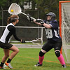 Beverly:<br /> Beverly's Hayley Lewis, left, shoots into the net, but Swampscott's goalie, Samantha Coogan, does not let the ball through during the Swampscott at Beverly girls lacrosse game at Hurd Stadium.<br /> Photo by Ken Yuszkus/Salem News, Monday, May 16, 2011.