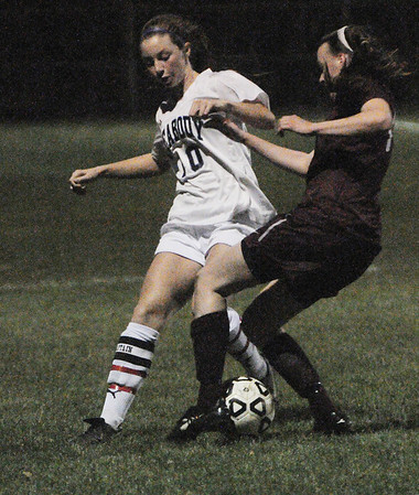 Peabody:<br /> Peabody's Madison Doherty, left, keeps the ball during the Westford Academy at Peabody State tournament girls soccer game in Division 1 North.<br /> Photo by Ken Yuszkus/Salem News, Monday, November 7, 2011.