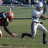 Ipswich:<br /> Hamilton-Wenham's Steve Turpin runs the ball with Ipswich's Jordan Thibault on his heels during the Hamilton-Wenham at Ipswich football game on Thanksgiving Day.<br /> Photo by Ken Yuszkus/Salem News, Thursday, November 24, 2011.