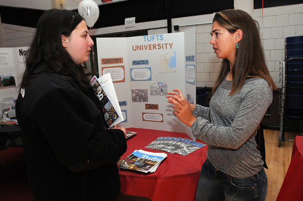 Salem:<br /> Suzanne Shahin, left, a junior at Salem High School, speaks with Paula Grasberger, a sophmore at Tufts University, about Tufts during the fifth-annual alumni college forum at Salem High School.<br /> Photo by Ken Yuszkus/Salem News, Thursday, January 5, 2012.