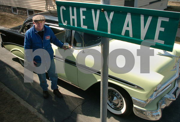 """Peabody:<br /> Billy Dunn created a street sign that says, """"Chevy St."""" because of his love of Chevys. He is standing next to his classic 56 Chevy BelAir in his driveway.<br /> Photo by Ken Yuszkus/Salem News, Friday, March 20, 2009."""